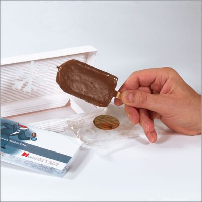 """Direct Mailing """"Warmer Eislutscher"""" Schokoladeüberzogenes Bisquitgebäck in Cellophanverpackung"""